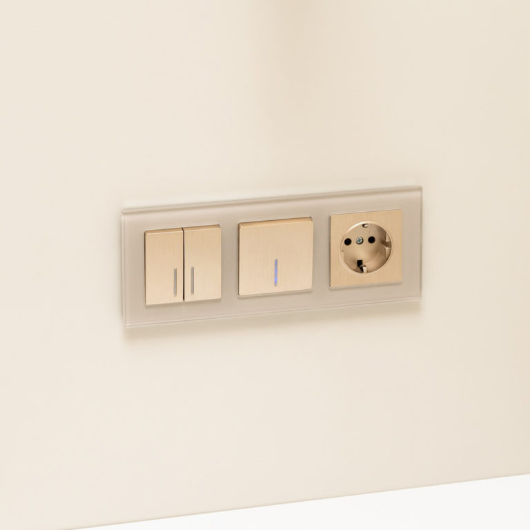 Выключатель одноклавишный с подсветкой (шампань рифленый) W1110110